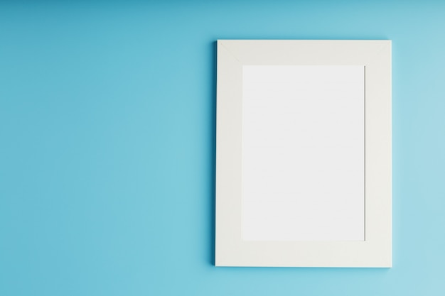 White and black photo frame with empty space on a blue background.