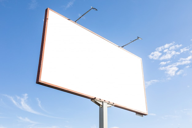 White blank advertisement billboard mockup against blue sky