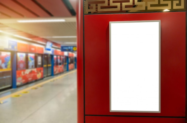 White blank billboard or advertising light box on red wall in subway train station, advertisement, commercial, marketing, advertising concept