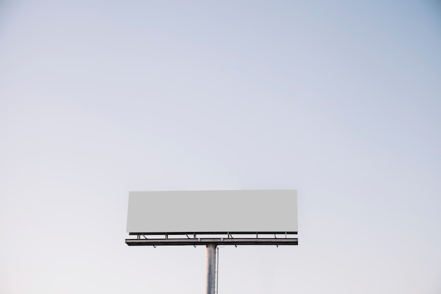 White blank billboard against blue sky