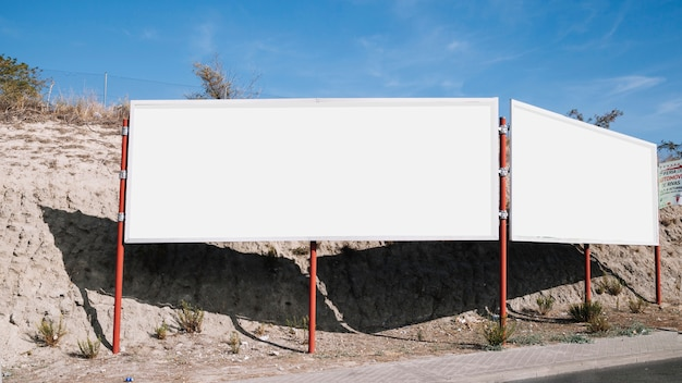 White blank billboard near the road