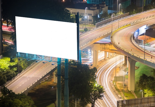 White blank billboard with highway road in background, public banner in a city