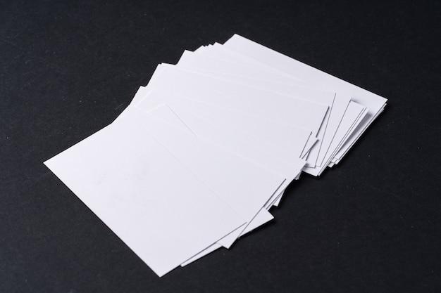 White blank business cards on dark black background