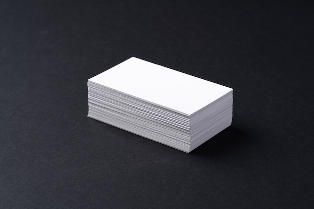 White blank business cards on dark black table