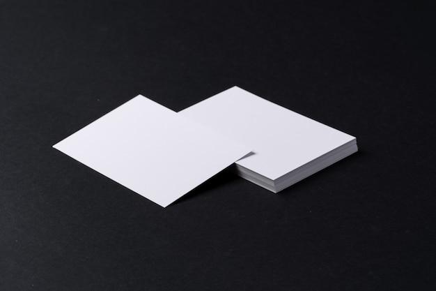 White blank business cards on dark black