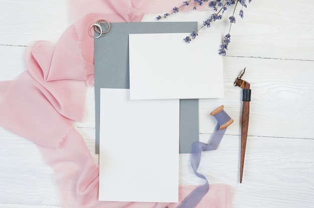 White blank cards with wedding rings and pink fabric with lavender flowers