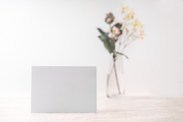 White blank letter greeting card. romantic love letter, invitation with flowers, copy space for text