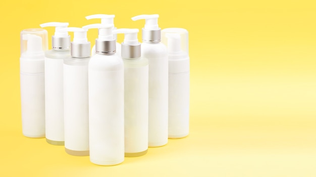 White blank mockup bottle cream container and spray standing on shipping boxes.