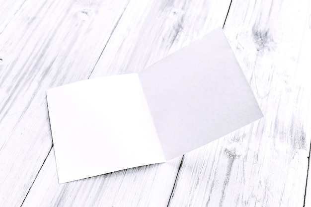 White blank paper magazine mockup on wooden table