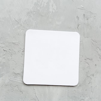 White blank paper notepad on gray table in office or home
