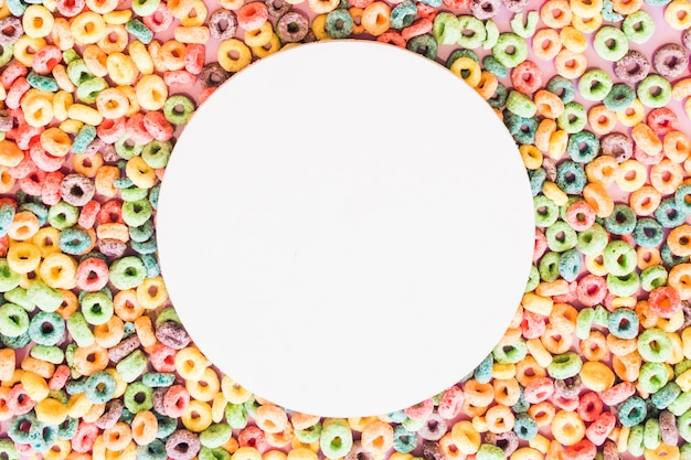 White blank round frame on the colorful cereal loop rings backdrop