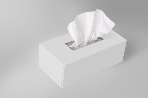 White blank tissue box on gray background with facial tissue