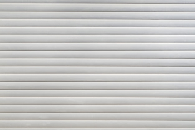White blinds with a lock on the window. blinds background.