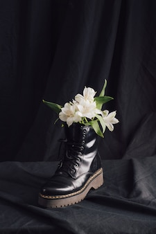 White blooms in dark boot