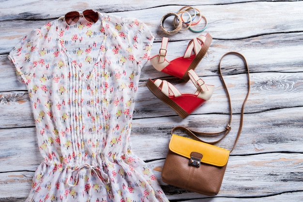 White blouse with colorful print. bicolor handbag, blouse and footwear. lady's outfit with colorful accessories. high-quality apparel.