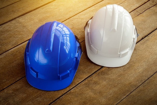 White, blue hard safety helmet construction hat for safety project of workman as engineer or worker