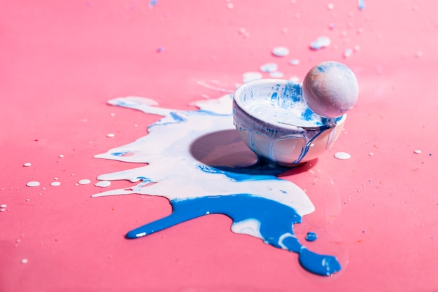 White and blue paint splash and cup abstract background