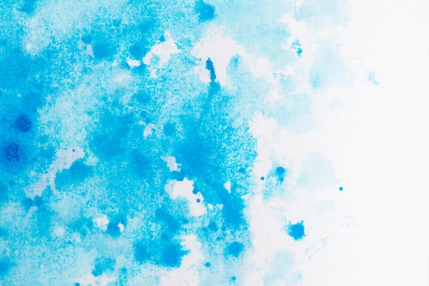 White and blue painting stains