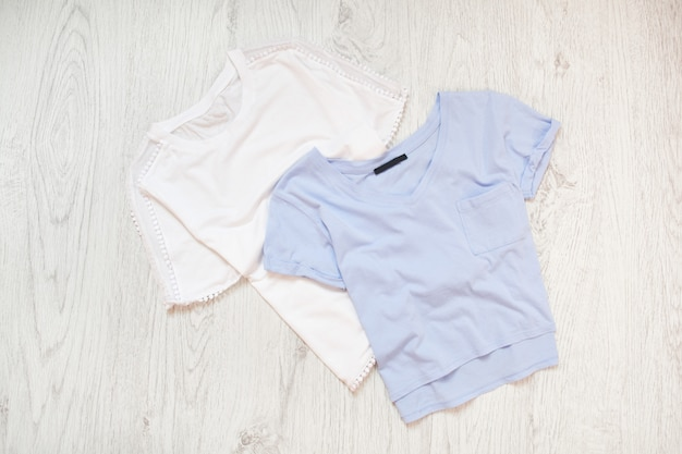 White and blue tee shirts for babies. fashionable concept