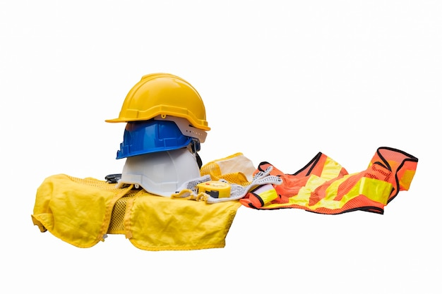 White, blue and yellow safety hard helmet with formal waistcoat for industrial safety workman on white background