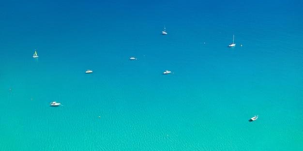 White boats at ancor on calm mediterranean sea. aerial minimal landscape panorama