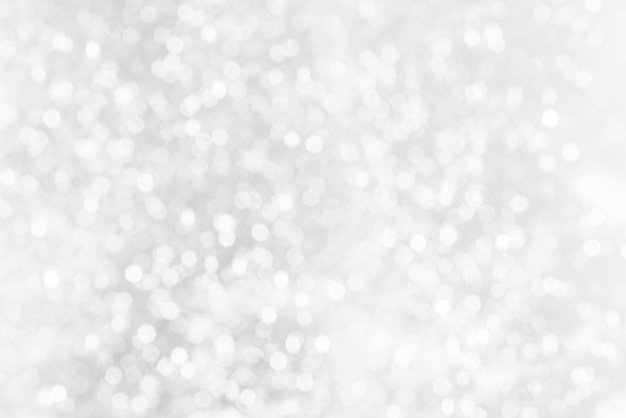 White bokeh abstract texture. blurred bright light at night.