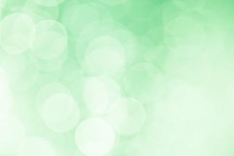 White bokeh on green background