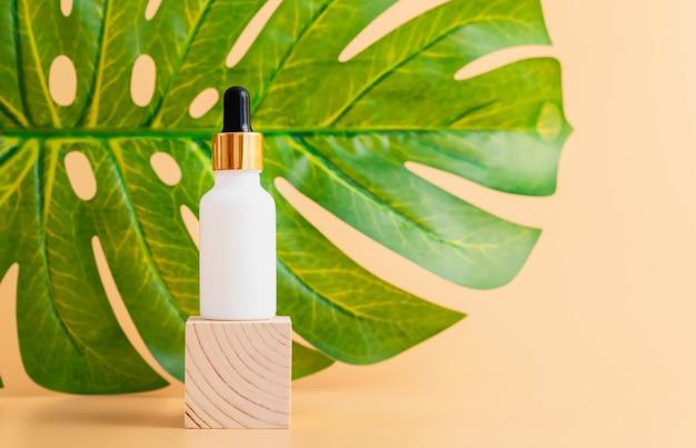 White bottle cream, mockup of beauty product brand on the orange background.