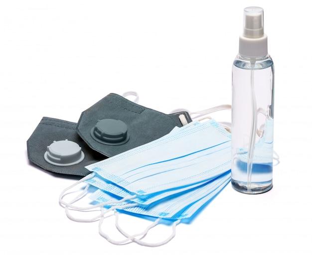 クリーム、ローション、消毒剤または液体石鹸、白い背景で隔離の防護マスクの白いボトル