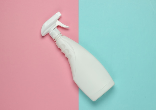 White bottle of spray for cleaning on a blue pink pastel background. top view. minimalism