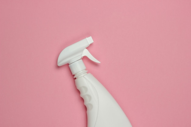 White bottle of spray for cleaning on pink pastel background. top view. minimalism
