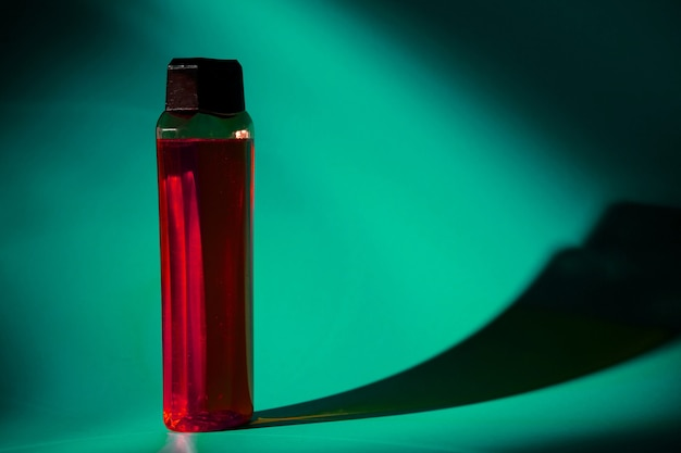 White bottle with cream, shampoo for hair, shower gel, colored background, beautiful studio light, beauty and youth of the human body