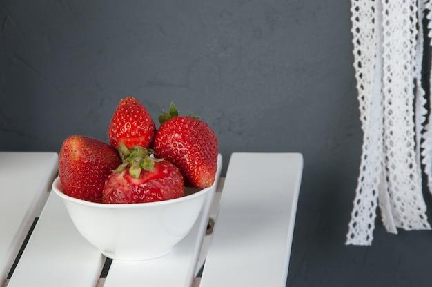White bowl of strawberry