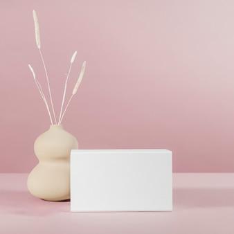 핑크에 흰색 상자 모형 디자인