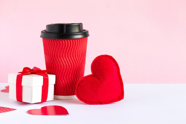White box with a gift, red cup of coffee and red heart
