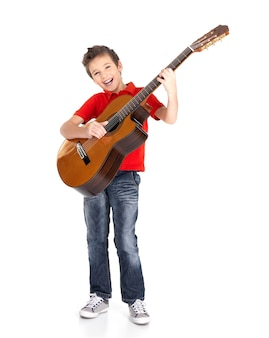 White boy sings and plays on the acoustic guitar isolated on white