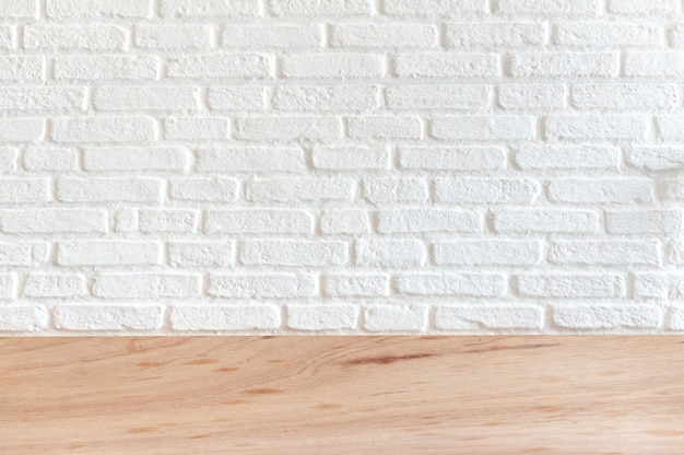 White brick background on a wooden surface. for placement of work pieces to present