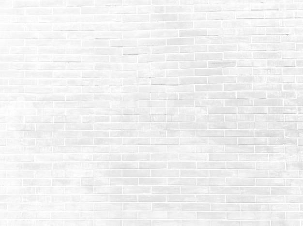 Белая кирпичная цементная стена фоновой текстуры для дизайна в стиле лофт