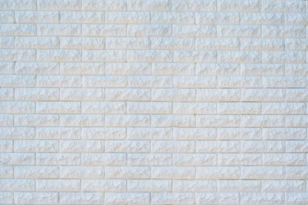 白いレンガの表面。抽象的な建設の背景。