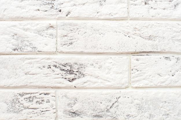 白いレンガの壁の背景。閉じる