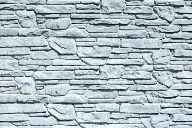 Белый фон кирпичной стены, шероховатые ржавые блоки каменной кладки обоев горизонтальной архитектуры.