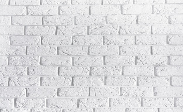 White brick wall home interior background , blank texture concrete cement pattern surface masonry brickwork abstract texture light aged paint grungy rusty blocks of stonework with copy space