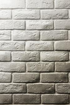 白いレンガの壁、影とグラデーション、ボリューム、白から灰色まで。デザインとレイアウトのためのテクスチャ空間