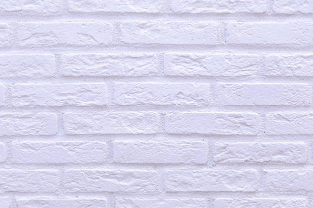 白いレンガの壁面。建設資材。