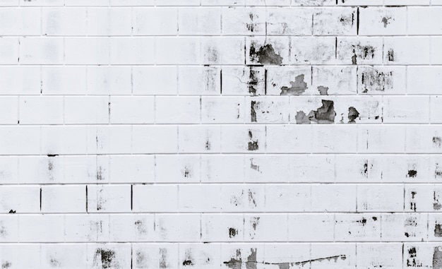 Белая предпосылка текстуры кирпичной стены. старая белая кирпичная стена с облупленной краской. пустая старая кирпичная стена. концепция экстерьера и интерьера дома.