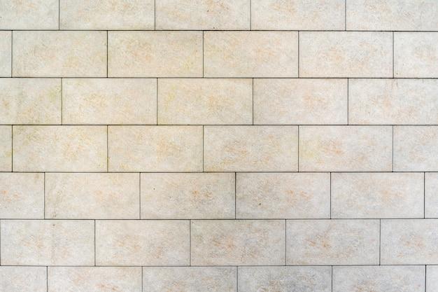 白いレンガの壁。灰色の詰物とレンガの質感