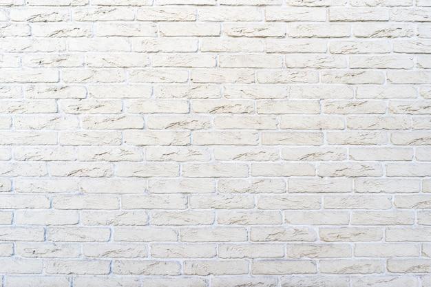 白いレンガの壁。白い詰物とレンガの質感
