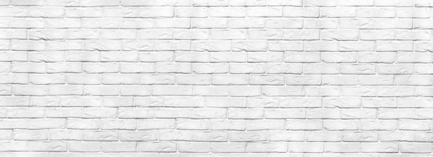 Белая кирпичная стена текстуры панорамный фон. дом и офис вымыли дизайн фона. стена из крашеного кирпича