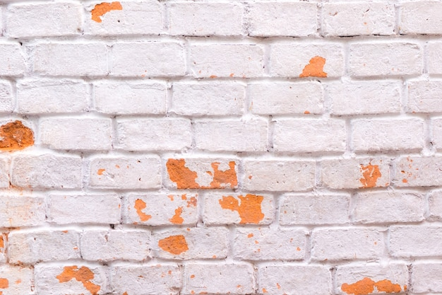 White brick wall with orange color texture and background