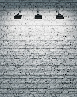 3 개의 스포트 라이트가 켜지는 흰색 벽돌 벽